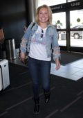 Hayden Panettiere is all smiles as she arrives with new boyfriend Brian Hickerson to catch a flight out of LAX airport, Los Angeles