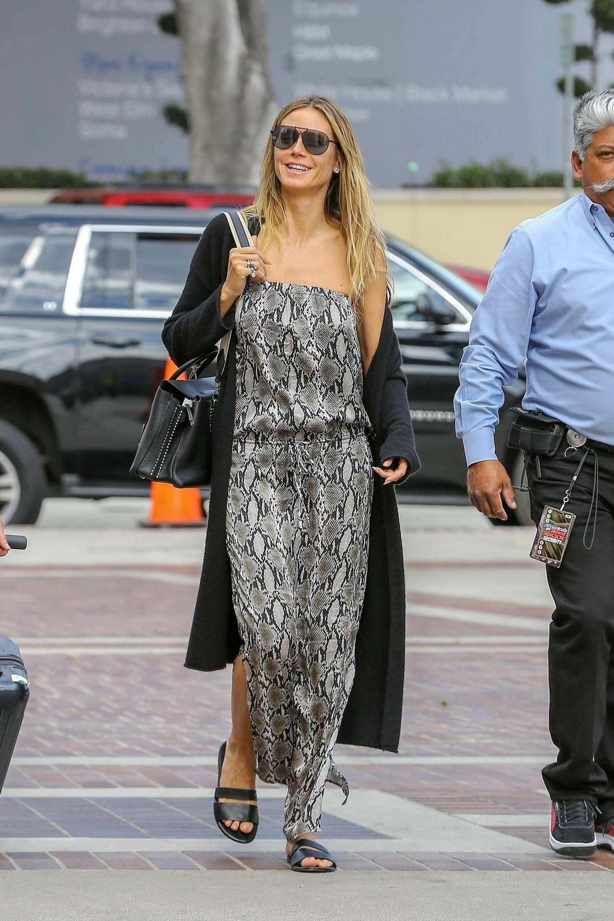 Heidi Klum wearing snakeskin print dress as she arrives to tape 'America's Got Talent' in Los Angeles