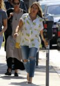 Hilary Duff seen wearing a lemon printed white shirt and jeans while out for lunch with a friend in Los Angeles