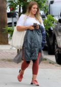 Hilary Duff walks back to her car as she leaves a nail salon in Studio City, Los Angeles