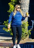 Hilary Duff wears a blue sweatshirt and black leggings while out to get an early breakfast in Los Angeles