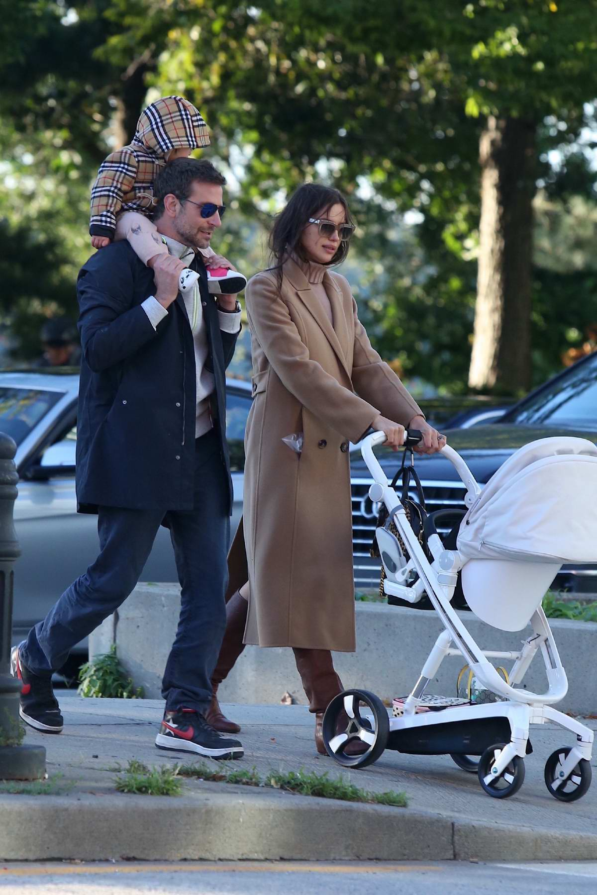 Irina Shayk and Bradley Cooper enjoys a stroll with their daughter in the West Village, New York City