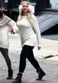Iskra Lawrence looks cute in fur earmuffs with white sweater and black leggings while enjoying a day out with friends in New York City