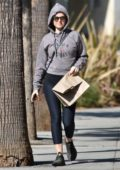 Isla Fisher keeps it casual in a hoodie and leggings while out for some shopping in Studio City, Los Angeles