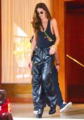 Izabel Goulart is all smiles as she heads out for an event wearing a black tank top and PVC pants in Sao Paolo, Brazil
