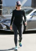 Jennifer Garner steps out in a black top, grey leggings paired with colorful sneakers and baseball cap while running errands in Los Angeles