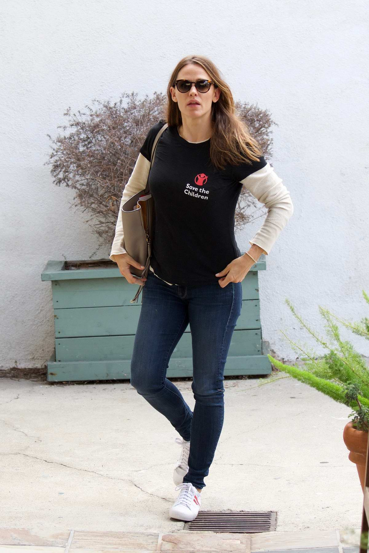 Jennifer Garner wears an 'Save The Children' t-shirt while taking her son to his martial art class in Brentwood, Los Angeles