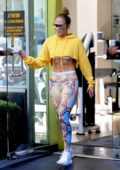 Jennifer Lopez rocks snakeskin print gym wear with a yellow hoodie while heading to the gym, later seen at Noah's Bagels in Westwood, Los Angeles