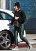 Jennifer Love Hewitt wore a black sweatshirt and animal print green leggings as she leaves the gym in Los Angeles