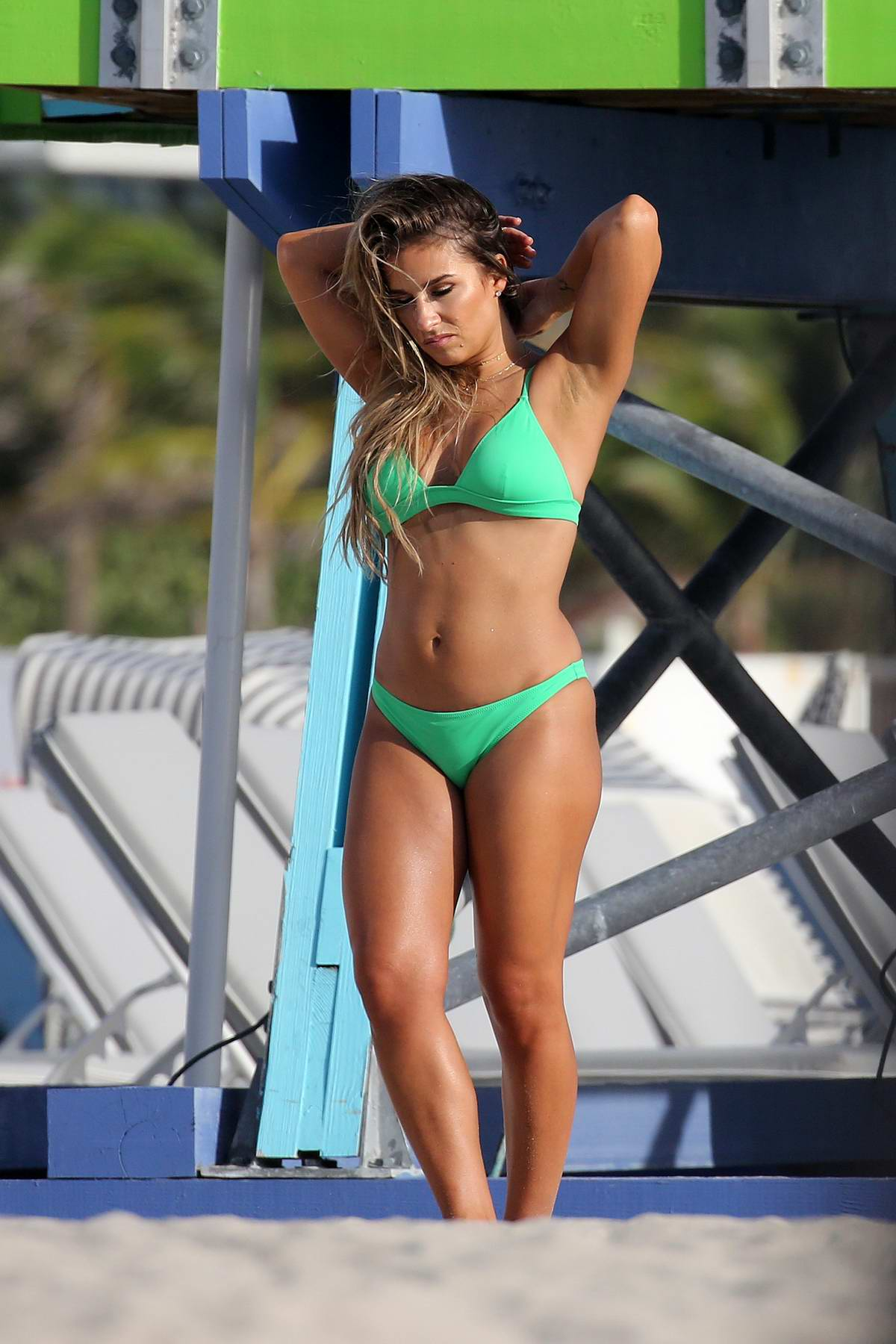 Jessie James Decker wears a bright green bikini while filming a commercial on Miami beach, Florida