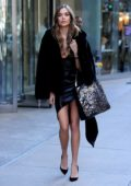 Josephine Skriver seen wearing black fur coat with a short black dress as she arrives for fittings at the Victoria's Secret offices in New York City