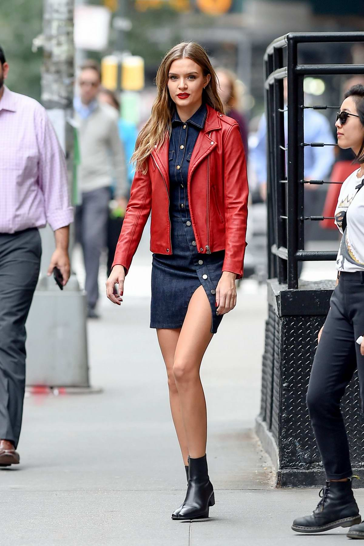 Josephine Skriver wearing a red leather jacket with a ...