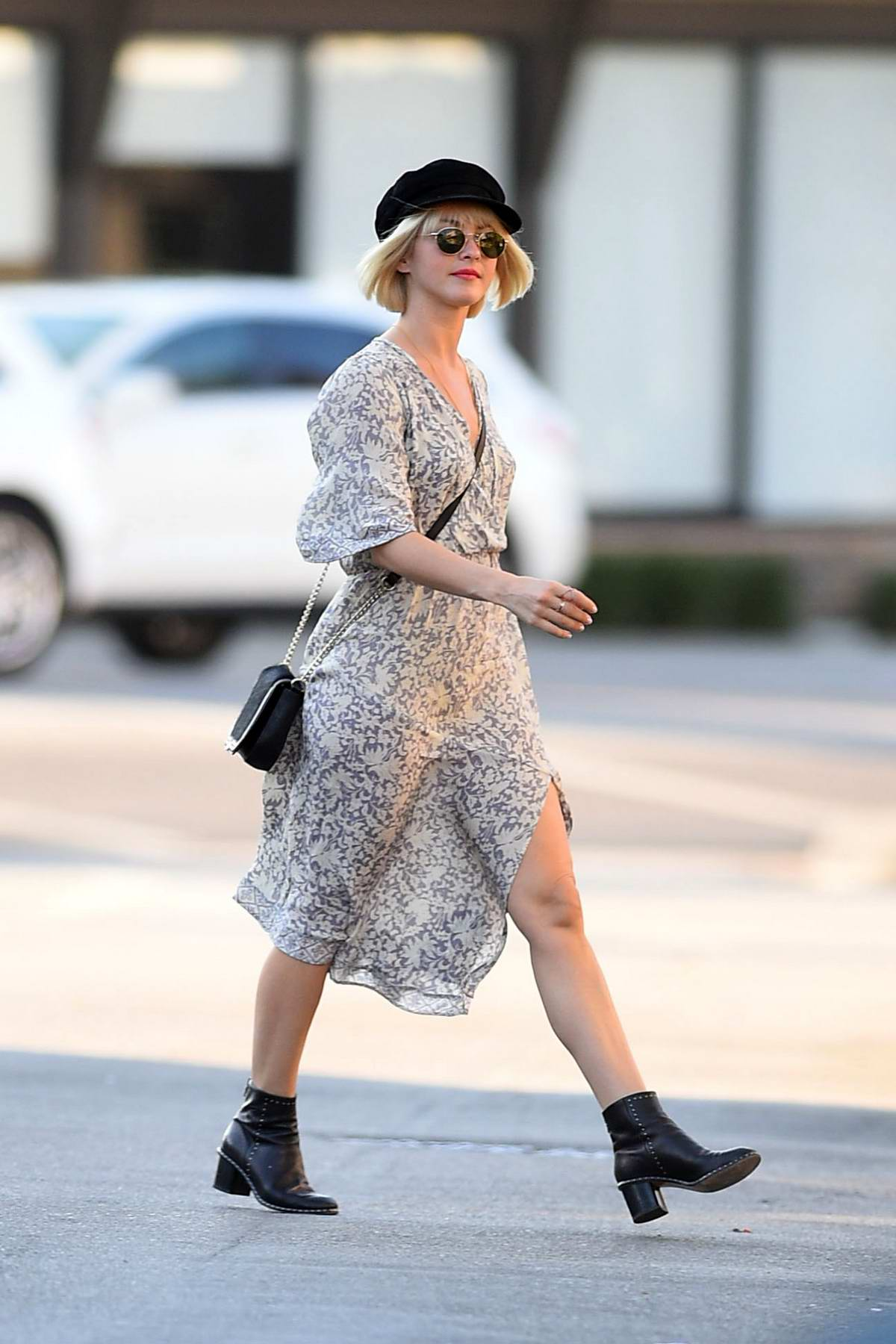 Julianne Hough looks lovely in a patterned white dress paired with ankle high boots and a black hat while out in Los Angeles