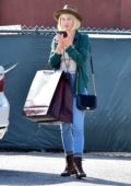 Julianne Hough looks stylish in a brown hat with a green shirt, skinny jeans and brown boots while out shopping in Beverly Hills, Los Angeles