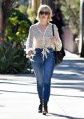 Julianne Hough wears a sheer white blouse and skinny jeans as she heads out in Los Angeles