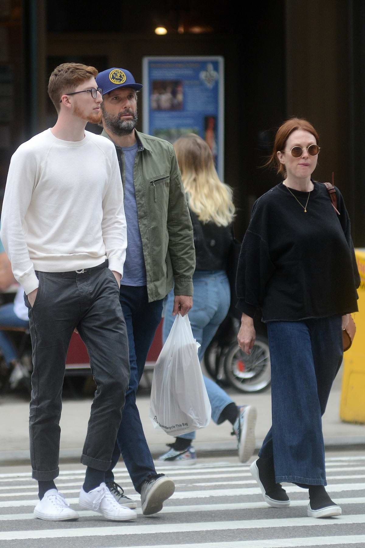 Julianne Moore and Bart Freudlich are spotted out with their son Caleb in SoHo, New York City