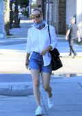 Kaley Cuoco wore a tight neck scarf with a white shirt and jean shorts as she heads to a studio in Los Angeles