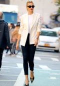 Karlie Kloss looks stylish in a white blazer and black skinny jeans while out in New York City