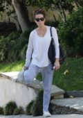 Kate Beckinsale steps out in a long sleeve white top and grey sweatpants as she heads to the gym in Los Angeles