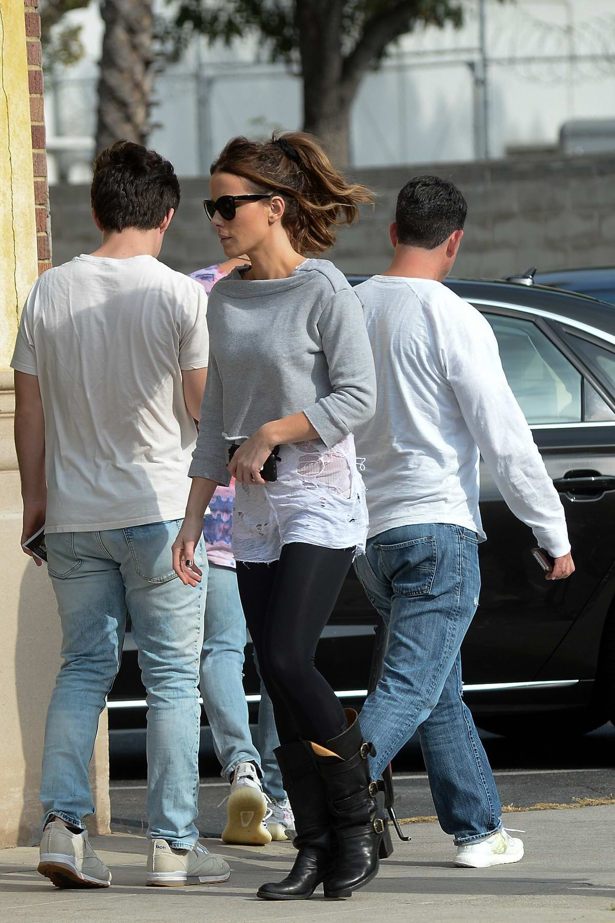 Kate Beckinsale wore a cropped grey sweatshirt, black leggings with black leather boots while stepping out to grab a quick smoke outside a studio in Los Angeles