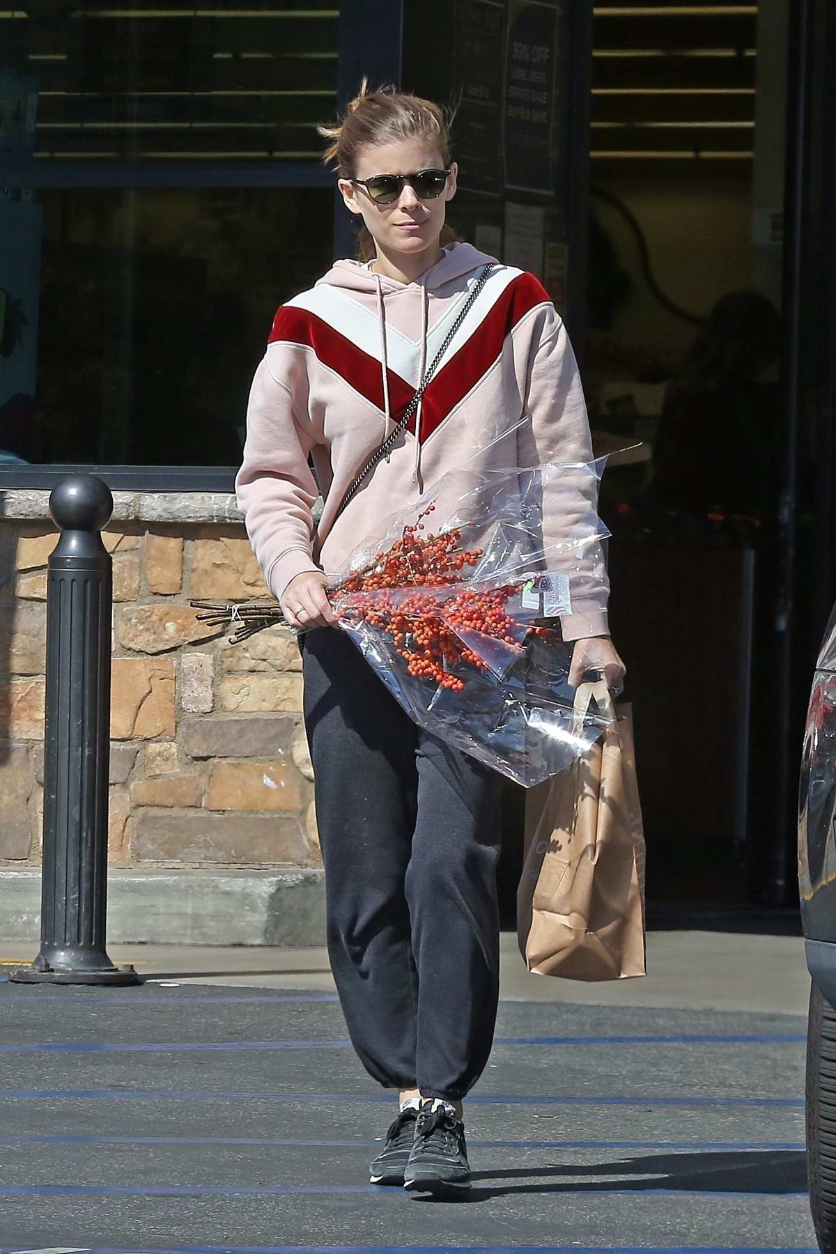 Kate Mara keep it comfy in her sweats while she picks up some flowers and groceries at Gelson's in Los Angeles