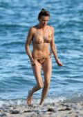 Katie Cassidy wears a print bikini as she takes a dip in the ocean while enjoying the beach with her fiance Matthew Rodgers in Miami, Florida