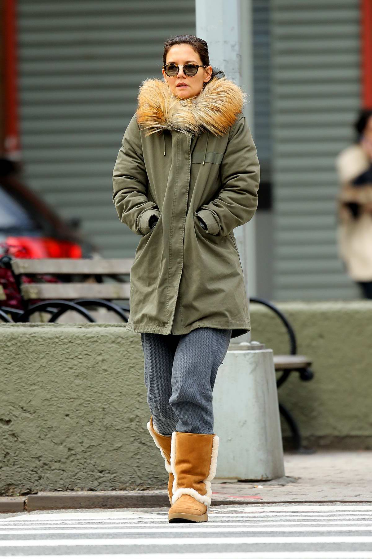 Katie Holmes wears a fur-lined parka with UGG boots while out for a stroll in New York City