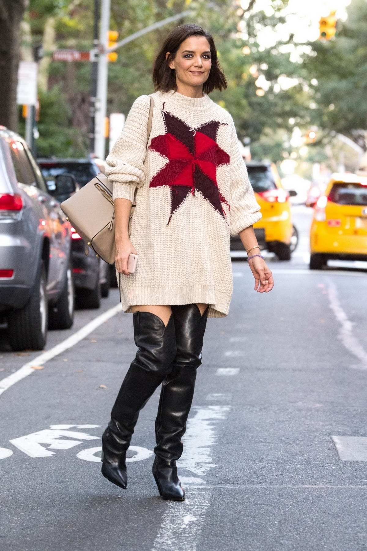 Katie Holmes wears an oversized knitted sweater with thigh high black boots while out in Gramercy Park, New York City