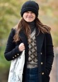 Keira Knightley bundles up in a black trench coat, sweater and a beanie while out in London, UK
