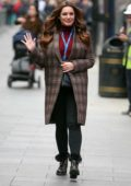 Kelly Brook looks lovely in a maroon turtleneck with checkered tweed coat while arriving at the Global Radio in London, UK