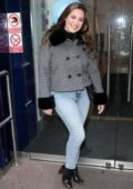 Kelly Brook seen wearing a fur-trimmed tweed jacket and jeans as she visits Global Radio studios in London, UK