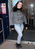 Kelly Brook seen wearing a fur-trimmed tweed jacket and jeans as she visits Global Radio studios in London, UK
