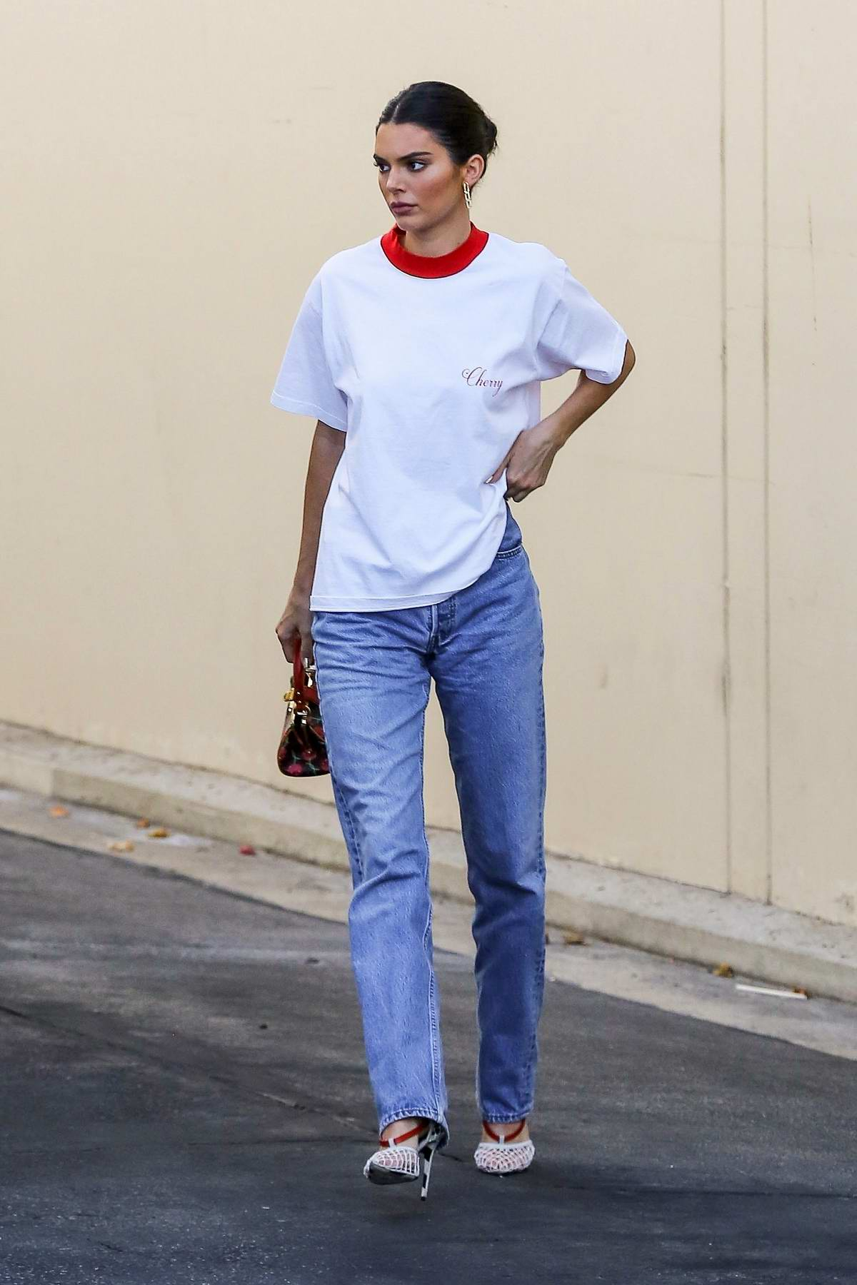 f9bff34d090 Kendall Jenner keeps it casual with a white top and blue jeans as she leaves  the