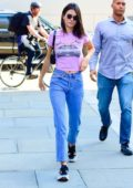 Kendall Jenner sports a casual look with pink top, high waisted jeans and Adidas trainers as she heads out in New York City