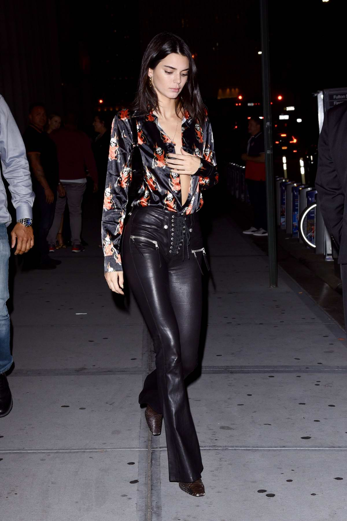 Kendall Jenner wears a patterned black silk shirt and leather pants as she grabs dinner with Kris Jenner at Nobu restaurant in New York City