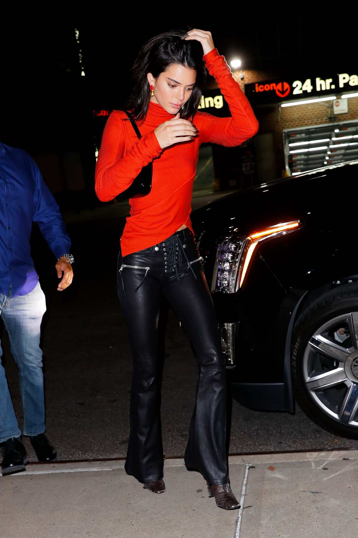 Kendall Jenner wears a red top and black leather pants as she heads to Bella Hadid's birthday party in New York City
