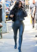 Kim Kardashian rocks dark grey leather bodysuit with matching boots and cropped denim jacket while out in Tribeca, New York City