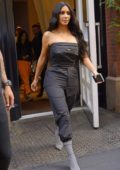 Kim Kardashian steps out of The Mercer Hotel in a strapless Prada jumpsuit in New York City