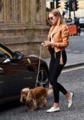 Kimberley Garner walks her dog before driving away her Ferrari in Kensington, UK