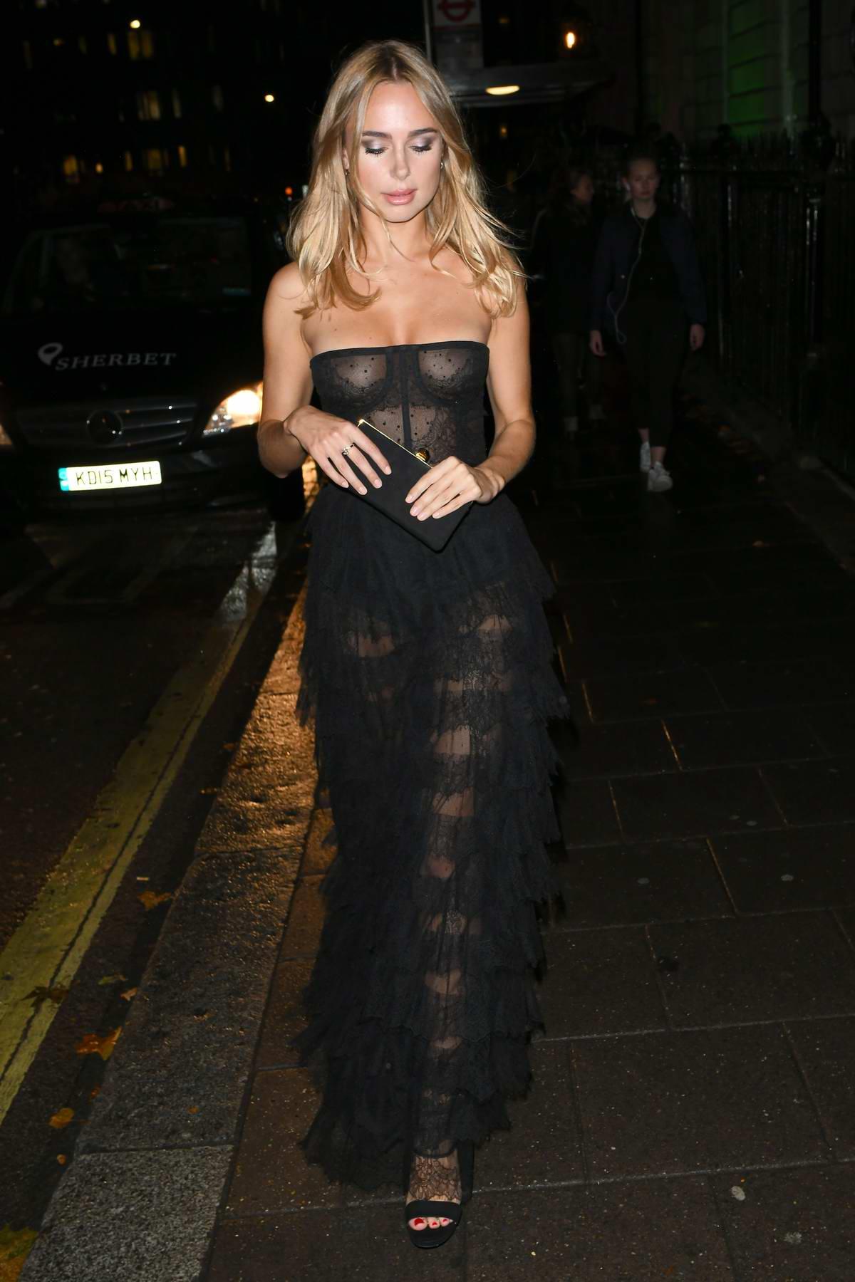 Kimberley Garner wears a black sheer dress while attending International Day Of The Girl Gala at Annabel's in London, UK