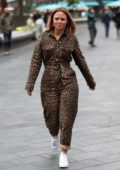 Kimberley Walsh wears an animal print jumpsuit as she arrives at Global Radio in London, UK