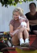 Kirsten Dunst filming scenes with a baby for her new AMC series 'On Becoming A God' in Florida