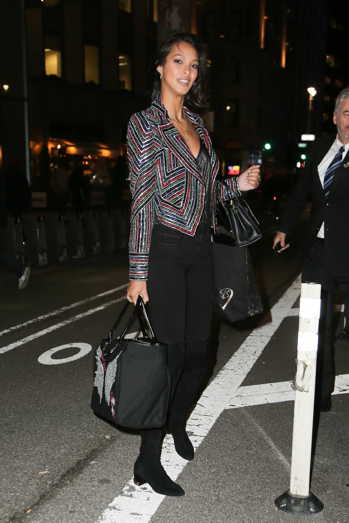 Lais Ribeiro wore a funky jacket with black jeans as she leaves the Victoria's Secret offices in New York City