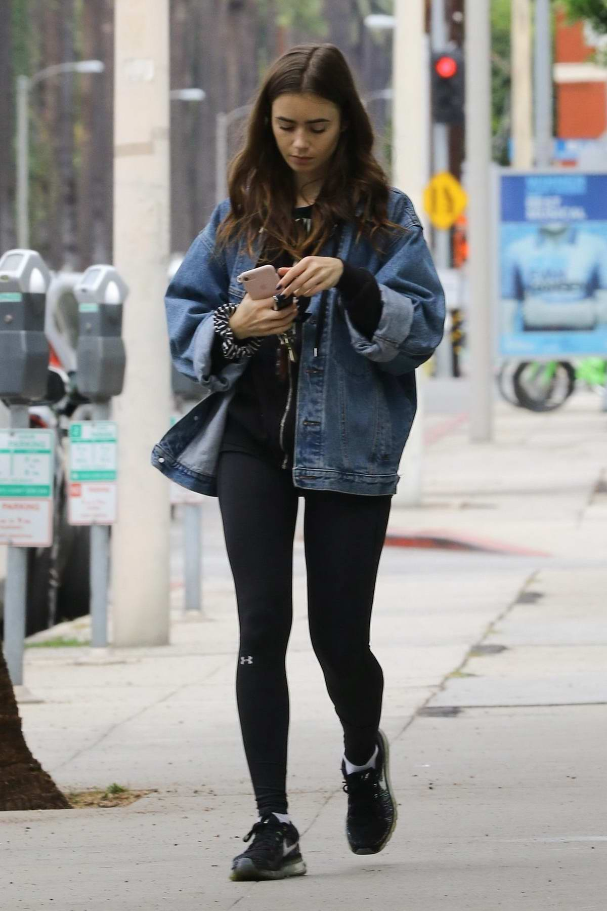 Lily Collins steps out in the rain to run errands in Los Angeles