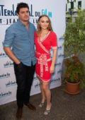 Lily-Rose Depp wears a bright red wrap dress during the 5th International Film Festival of St Jean de Luz, France