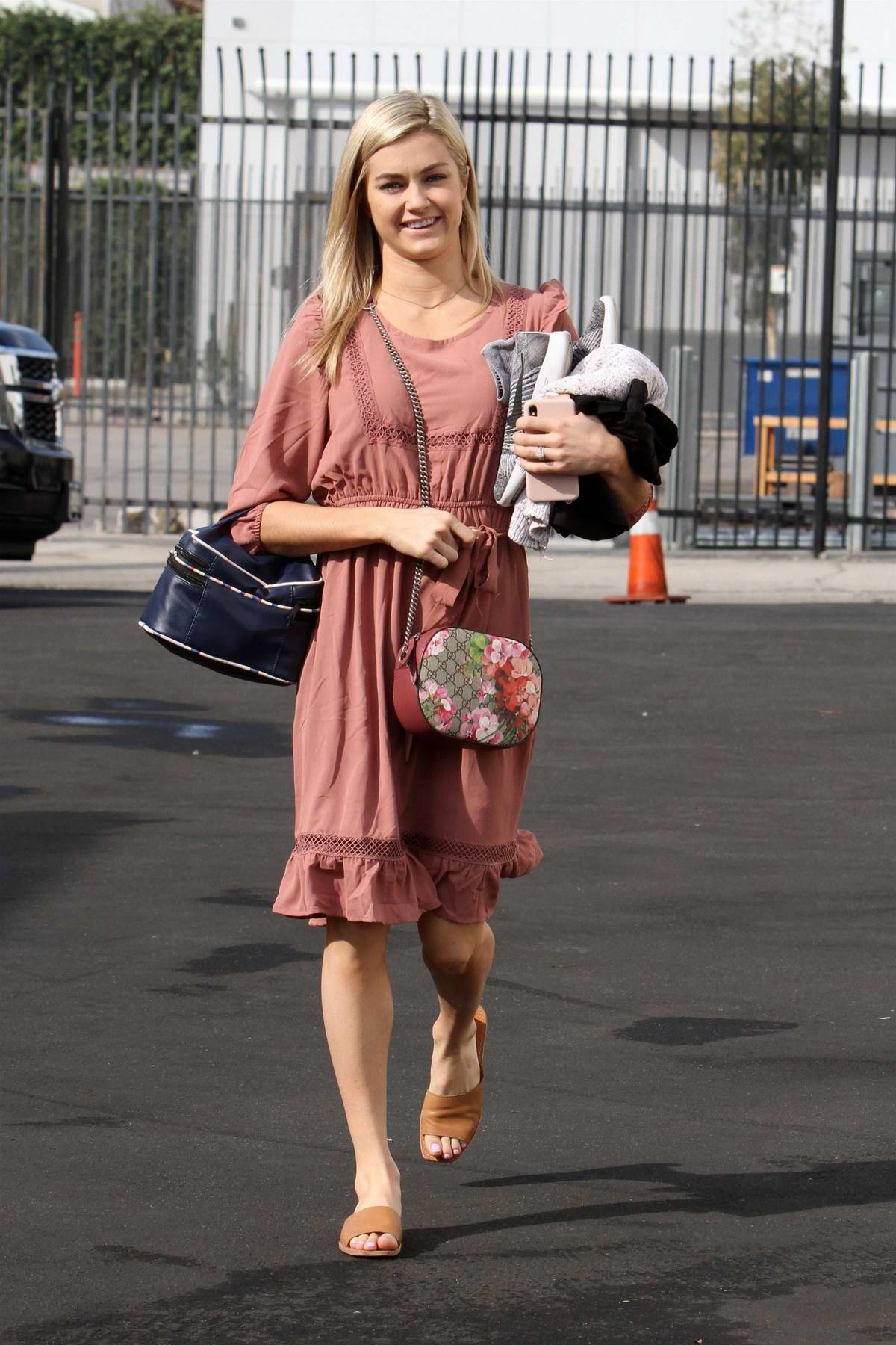 Lindsay Arnold looks lovely in peach colored dress as she arrives at the DWTS studio in Los Angeles