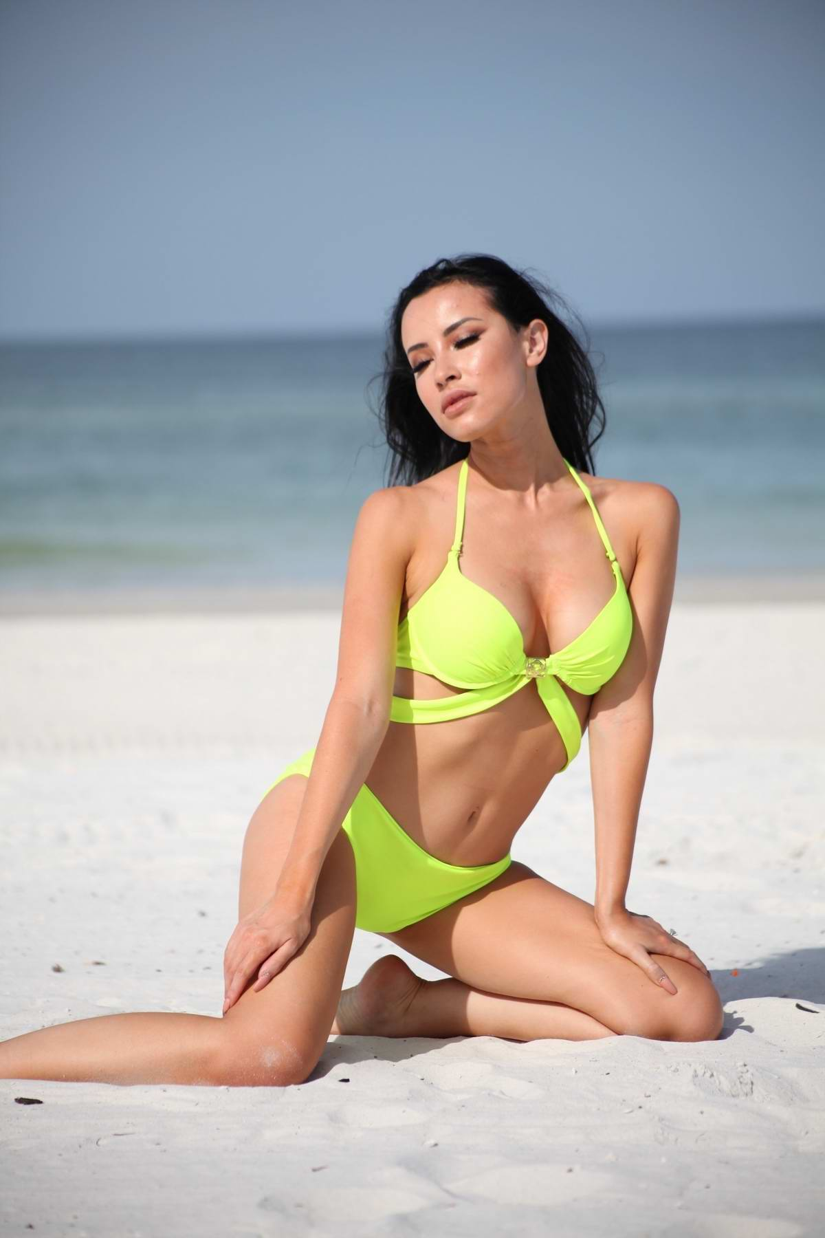 Lisa Opie wears a neon bikini while enjoying a sunny day at the beach in Miami, Florida