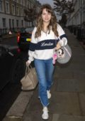 Lottie Moss sports a new brunette look as she heads out with her pup in London, UK