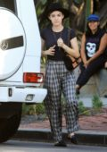 Lucy Hale looks stylish in a black hat with baggy plaid pants and a black top during a shopping trip on Melrose Place in West Hollywood, Los Angeles