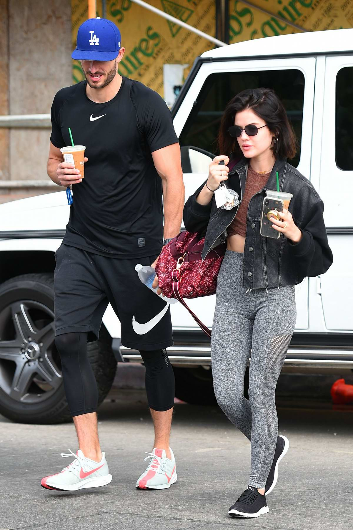 Lucy Hale meets with her trainer at her car as they head to the gym in Los Angeles